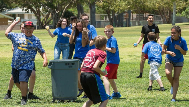 Campers with the Las Cruces Police Department's Youth Leadership Camp engage in a large water balloon fight Thursday June 7, 2018 at Young Park. The water balloon fight is held on the penultimate day of the week-long camp.
