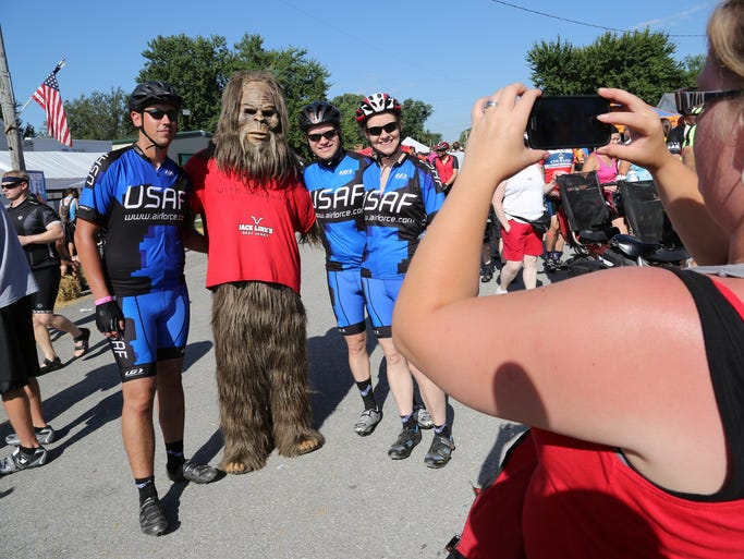 Nina Brumley OK, Chance Brumley, from texas, Mike Hanson, Osage, all on Team Air Force, and are all stationed in Oklahoma. They had their photo taken with Sasquatch in Underwood.  RAGBRAI 41 Sunday. Riders make their way from Council Bluffs to Harlan.