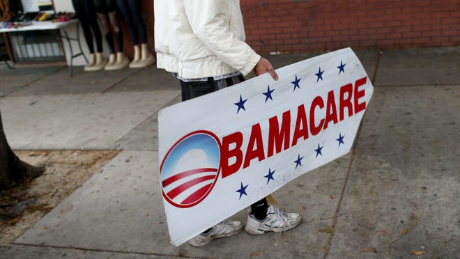 In New Jersey, 252,792 consumers signed up for private health insurance coverage through Obamacare in 2015. Pedro Rojas on Feb. 5 holds a sign directing people to an insurance company where they can sign up for the Affordable Care Act, also known as Obamacare, in Miami, Florida.