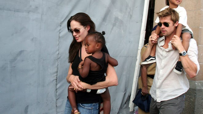 In this Nov. 12, 2006 file photo, American actress and UNHCR Ambassador Angelina Jolie, left, with her daughter Zahara, and Brad Pitt, right, with Jolie's son Maddox, walk near the Gateway of India in Mumbai, India. Angelina Jolie Pitt has filed for divorce from Brad Pitt, bringing an end to one of the world's most star-studded, tabloid-generating romances. An attorney for Jolie Pitt, Robert Offer, said Tuesday, Sept. 20, 2016, that she has filed for the dissolution of the marriage.