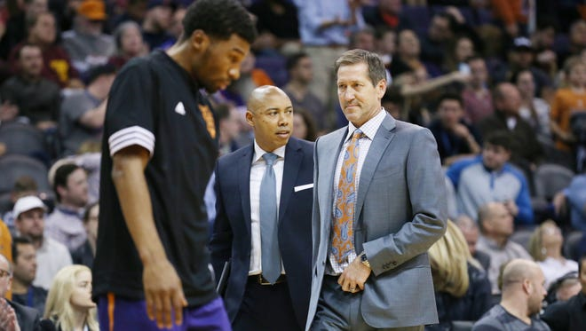 Phoenix Suns head coach Jeff Hornacek (center) talks to the coaching staff during the game against the Cleveland Cavaliers in 4th quarter on Monday Dec. 28, 2015 at Talking Stick Resort Arena.