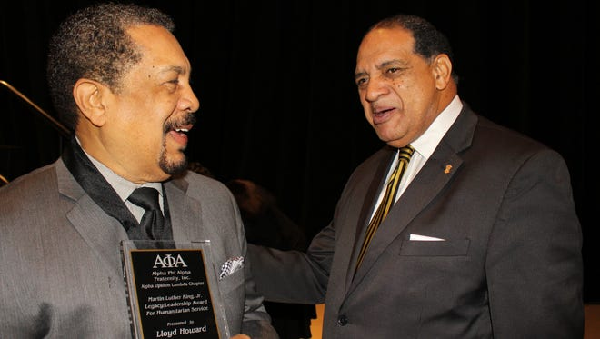 Legacy Award honoree Lloyd Howard, left, chats with Martin Luther King Jr. Breakfast speaker Hilton O. Smith Saturday morning.  (Alvin Benn, Special to the Advertiser)