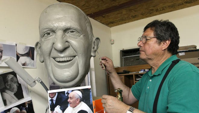 Sculptor Pedro Francisco Rodríguez works on the head of the statue that he is creating of Pope Francis that will be unveiled during the pope's visit in Juárez on Feb. 17.