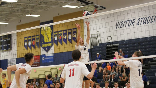 Marquette's Conor Ward sets up a play.