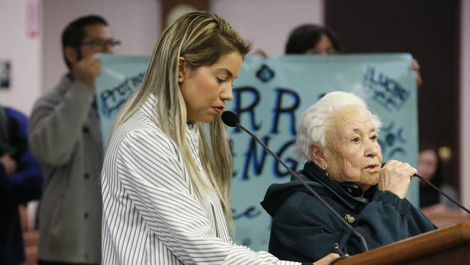 El Paso resident Antonia Morales, right, speaks against the proposed arena site at the City Council meeting on Tuesday. Standing next to her is the city's interpreter.