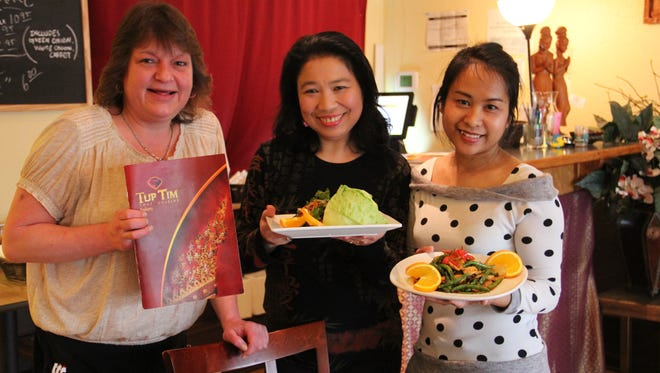 Vichuda Stine (center) owns Tup Tim Thai Cuisine in South Salem, where she serves Thai favorites and unique, hard-to-find items.