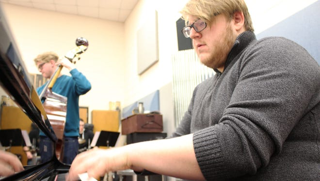 Sam Oswald of Manitowoc plays piano while William DeBlaey plays bass in the six-member Augmented Six jazz combo that formed at UW-Sheboygan.