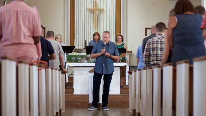 Rev. James Pennington leads the opening prayer at First Congregational United Church of Christ in Phoenix, Ariz. on Sunday Aug. 3, 2017.