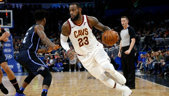 Cleveland Cavaliers forward LeBron James (23) drives to the basket against the Orlando Magic during the second quarter at Amway Center.