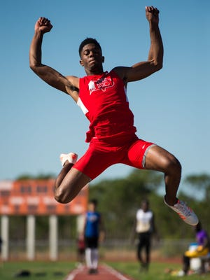 Vero Beach's Demarcus Harris takes first place in the boys long jump during the District 9-4A track and field meet Monday, April 16, 2018, at Port St. Lucie High School. Martin County, Treasure Coast, St. Lucie West Centennial, Fort Pierce Central, Vero Beach and Melbourne high schools participated in the meet.