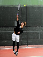 Wylie's Carson Cole serves at mixed doubles against