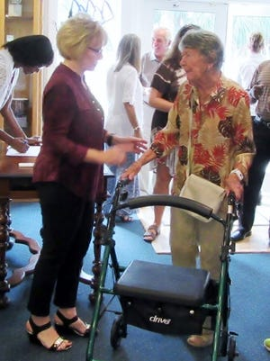 Dot Bombaci, left, welcomes Dorothy Brennan, founder of Learn to Read of St. Lucie County.  Brennan founded the organization in 1983 as a result of learning of a tragic incident that could have been prevented had the adult involved been able to read prescription instructions.