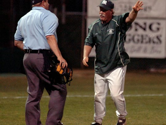 Pete Donovan talks to an umpire during a game against Eau Gallie High held at Melbourne High School on Wednesday, March 10, 2010.