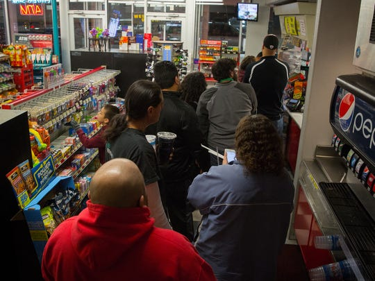 Customers throng to the Pic Quik convenience store on Missouri Avenue on to buy Powerball lottery tickets. The estimated jackpot for the drawing on Wednesday night is expected to to reach a record high of $1.5 billion.