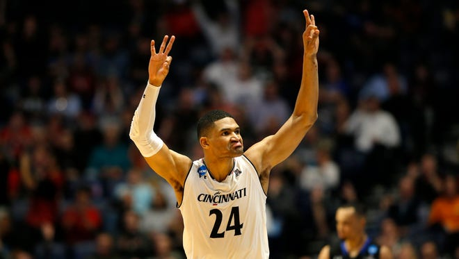 Cincinnati Bearcats forward Kyle Washington (24) throws up his hands after sinking a three point shot in the first half of the NCAA Tournament South Region First Round game between the 2-seeded Cincinnati Bearcats and the 15-seeded Georgia State Panthers at Bridgestone Arena in Nashville on Friday, March 16, 2018. The Bearcats led 35-30 at the end of the first half.