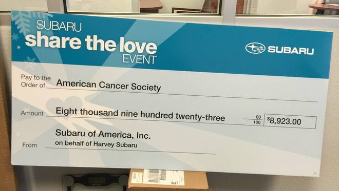 Subaru of America, on behalf of Harvey Subaru of Bossier City, presented a check for nearly $9,000 to the American Cancer Society .