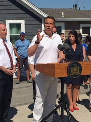Gov. Andrew Cuomo speaks at a news briefing in Greece. He was flanked by state Sen. Joe Robach, R-Greece, and Monroe County Executive Cheryl Dinolfo.