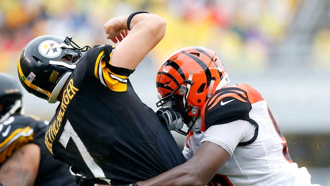 Steelers quarterback Ben Roethlisberger is brought down by Bengals defensive end Carlos Dunlap during Cincinnati's Sept. 18 loss.