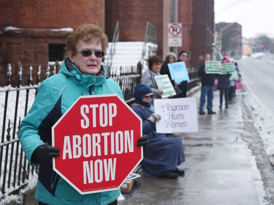 Gail Moore of Hyde Park, an abortion opponent, engages in a protest on Church Street in the City of Poughkeepsie.