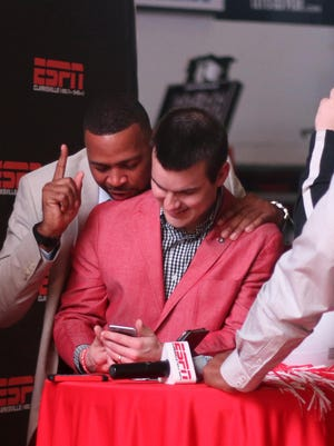 Austin Peay coach Will Healy and wide receivers coach Todd Pinkston FaceTime with players as they send in their National Letters of Intent on Wednesday. Austin Peay head coach Will Healy and wide receivers coach Todd Pinkston FaceTimes with players as they send in their papers to sign with Austin Peay on National Signing Day on Wednesday.
