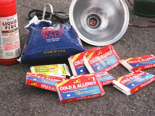 This 1998 photo shows items confiscated from a suspected meth lab in southwest Missouri, including cold medicine, rock salt and a heat lamp.