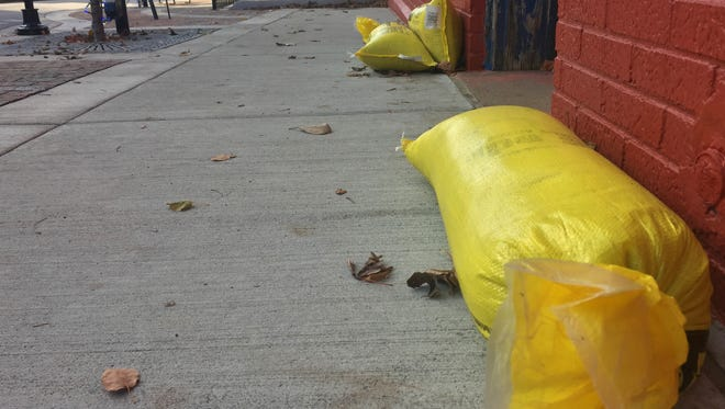 Sandbags sit outside One Earth Gallery and Gifts at 1010 Main St. The store is one of several that has taken on water since sidewalks were replaced in Lafayette's $5.5 million streetscape project.