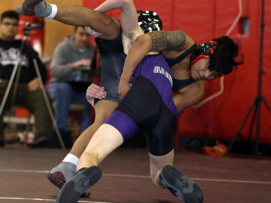 Action from a GMC wrestling meet held at Woodbridge High School included Woodbridge vs Old Bridge High School on Saturday January 16,2016.Here Alec Shea (right)  of Woodbridge High School battles with Alec Meyers of Old Bridge during their 113 lb. bout