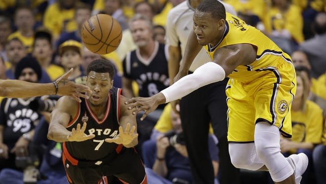 Indiana Pacers forward Lavoy Allen (5) fights for a loose ball with Toronto Raptors guard Kyle Lowry (7) in the first half of their Eastern Conference first round playoff game Thursday, April 21, 2016, evening at Bankers Life Fieldhouse.