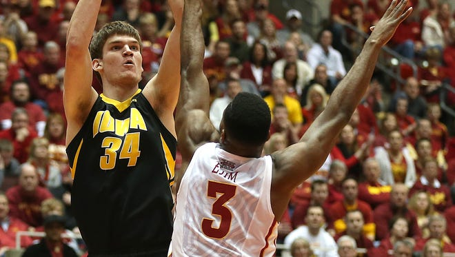 Adam Woodbury (34) came to the University of Iowa from Sioux City. Melvin Ejim (3) came to Iowa State from Toronto, Ontario.