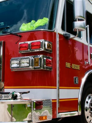 A file photo showing a fire engine. Reno firefighters say a man was hospitalized after he was pinned under a semitrailer.