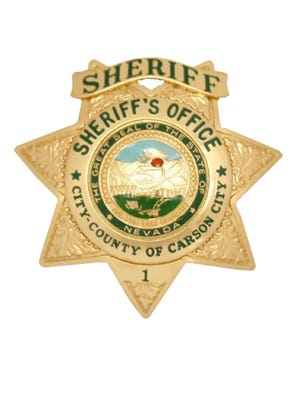 A file photo of the Carson City Sheriff's Office badge. Deputies are searching for a man, who they believe robbed two food delivery drivers on separate occasions.