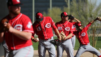 From left: Cincinnati Reds relief pitcher Barrett Astin (71), relief pitcher Zack Weiss (49), relief pitcher Tanner Rainey (80) and starting pitcher Jose Lopez (74) throw in the bullpen, Saturday, Feb. 17, 2018, at the Cincinnati Reds Spring Training facility in Goodyear, Arizona.