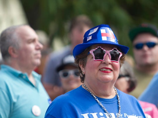 Lucy Garner waits in line to see former President Bill Clinton speak on Tuesday at Riverside Community Center in Fort Myers.