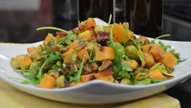 This Roasted Butternut Squash and Brussels Sprouts with Warm Bacon features a vinaigrette made with brown ale.