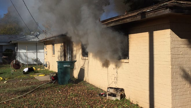 Smoke billows from a fire at 1834 Orange St.