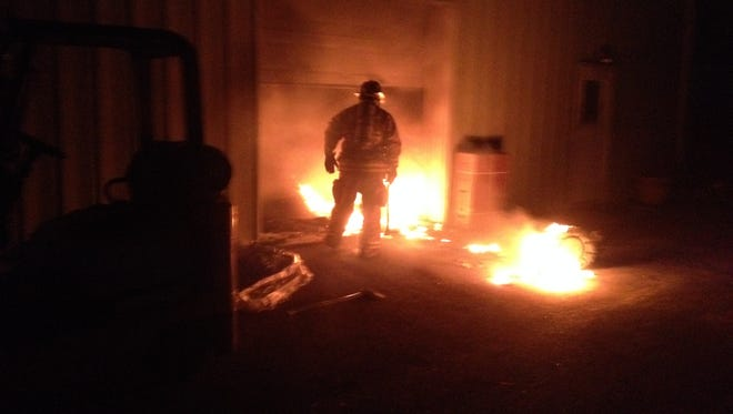 A Mountain Home firefighter stands at the entrance to a door where a blaze has erupted at Splashes on U.S. 62 Highway East.