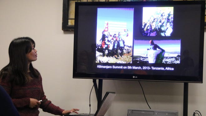 Nimdoma Sherpa talks about her mountain ventures and shows photos of herself and her climbing team of women.
