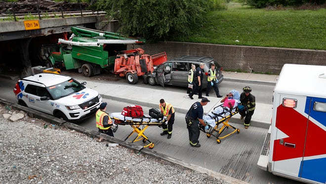 A minivan transporting many children rear ended a tree trimming bucket truck's wood chipper trailer after it struck the railroad bridge on South Rural Street just north of Newton AvenueMonday, June 25, 2018. Numerous children and adults from the minivan were transported to area hospitals.