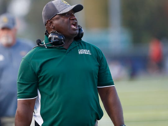 Ozzie Riley, Catholic's defensive line coach, is also