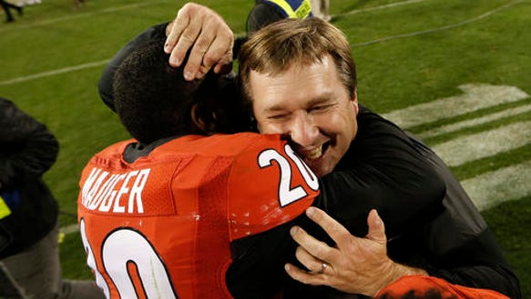 Georgia head coach Kirby Smart celebrates with safety