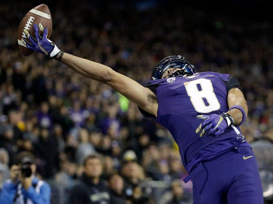 Washington's Dante Pettis just misses snagging a pass in the end zone against California in the first half of an NCAA college football game Saturday, Oct. 7, 2017, in Seattle. (AP Photo/Elaine Thompson)