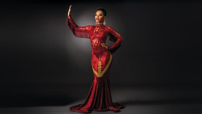 Davanique Collier models a gown by Rochester fashion designer Arlene Sutherland, originally from Jamaica, who specializes in gowns, swimwear and body suits.