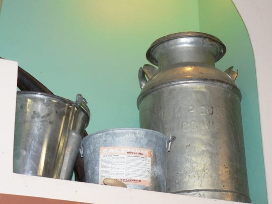 "During the ""boom days"" of  dairy farm numbers (in the 30s 40s and 50s), the milk can and pail were the  primary  tools of  the trade."
