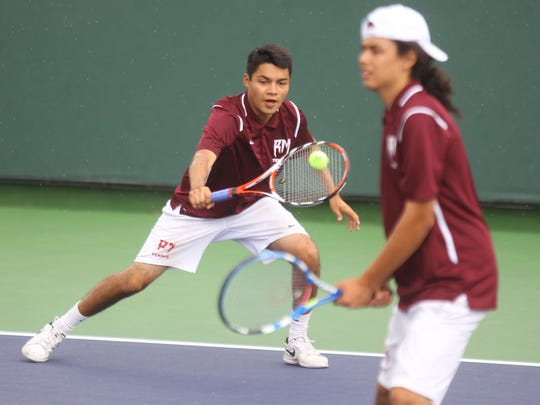 Rancho Mirage High's Luis Velazquez hits a backhand return as his partner Ivan Hernandez looks on during their De Anza League semifinal match against 29 Palms on Friday, May 6, 2016 at the Indian Wells Tennis Garden in Indian Wells.