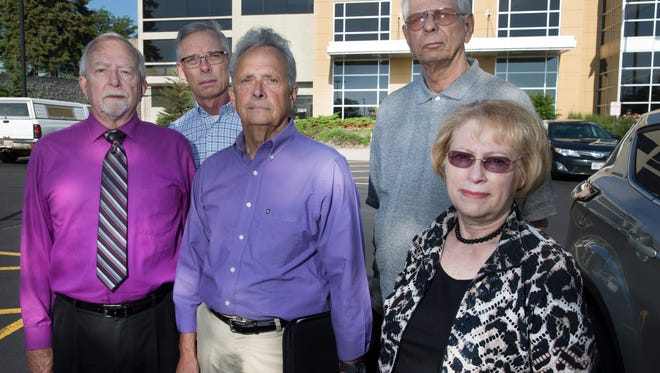 Former Germantown School District staff members Bill Gay (front left), Gary Finn, Jan Wienhold, David Cliff (rear left) and Roger Choinsky are shown Friday outside the Washington County Courthouse in West Bend. They are suing over lost long-term care coverage they had been promised and had been paying for when the School Board, after Act 10, eliminated the benefit for employees and in doing so negated the coverage retirees assumed they had.  MARK  HOFFMAN/MHOFFMAN@JOURNALSENTINEL.COM