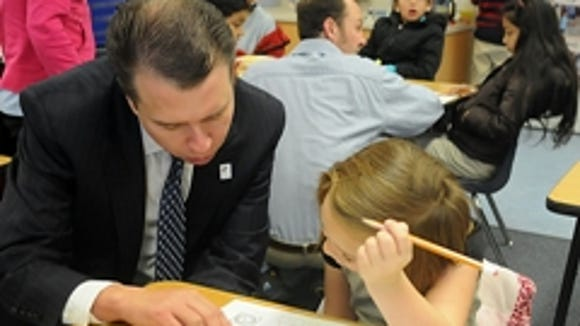 Washoe County School Superintendent Pedro Martinez talks with a student at Smithridge Elementary School earlier this year.
