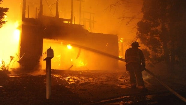Firefighters battle the Pinehave Fire in southwest Reno the morning of Friday, Nov. 18, 2011. Photo by David B. Parker.