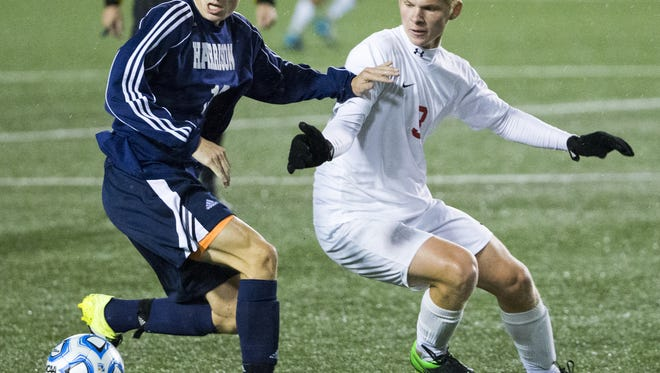 Nash Walker (left), Harrison, works against Conrad Bomber, Center Grove, IHSAA Boys Class 2A State Soccer Finals, won by Center Grove High School 4-0 over Harrison (West Lafayette) High School, Michael A. Carroll Track & Soccer Stadium, IUPUI, Indianapolis, Saturday, Oct. 31, 2015.