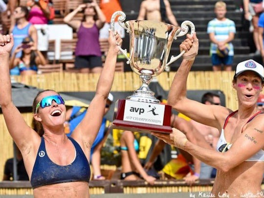 Fourth-seeded Brooke Sweat, left, and Lauren Fendrick beat No. 9 Betsi Flint and Kelley Larsen, 14-21, 21-10, 19-17 in the final of the AVP season-finale in Chicago Sunday, Sept. 4, 2016 for their first title as a team.