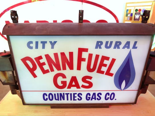 Front view of the PennFuel sign in the American Sign